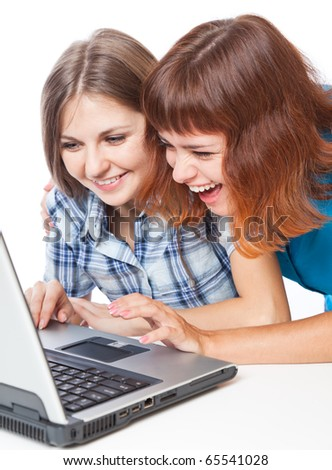 Two teen-girls with laptop. Isolated on white background - stock photo