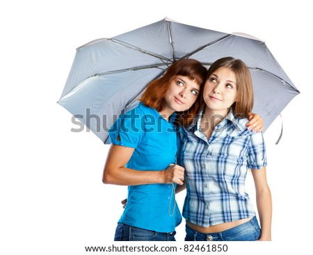Two teen-girls with umbrella. Isolated on white background - stock photo