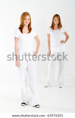 two teen sister in studio, full length - stock photo