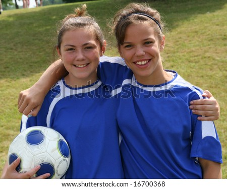 Two Teen Youth Soccer Teammates - stock photo