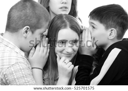 Two teenage boys and a girl gossiping about the second girl isolated on white background.