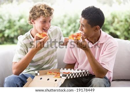 Two Teenage Boys Eating Pizza - stock photo