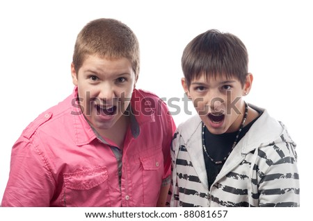 Two teenage boys shouting and screaming in surprise.