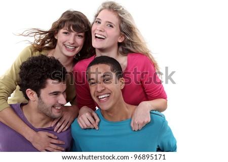 Two teenage couples in studio - stock photo
