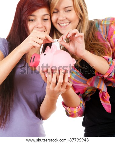 two teenage girls and money - stock photo