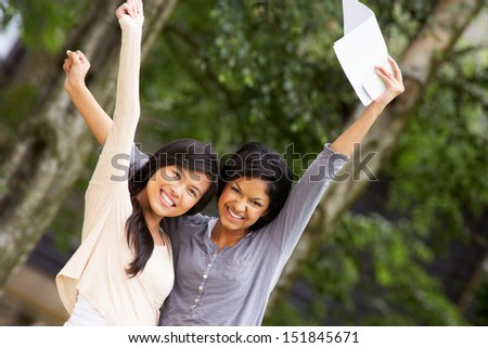 Two Teenage Girls Celebrating Successful Exam Results - stock photo