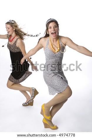 Two teenage girls dancing wildly. - stock photo