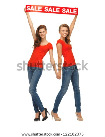 two teenage girls in red t-shirts with sale sign - stock photo