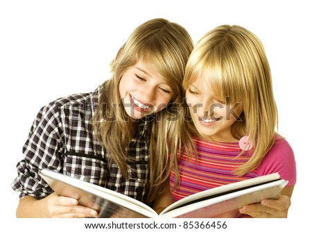 Two Teenage Girls reading The Book.Education - stock photo