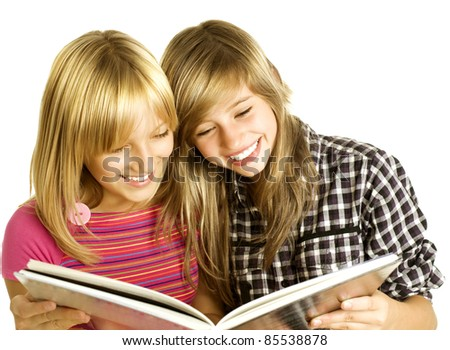 Two Teenage Girls reading The Book. Education - stock photo