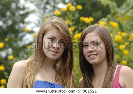 Two teenage girls spend some time outdoors. - stock photo