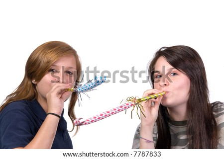 Two teenage girls with party noise makers shot over white - stock photo