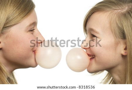 two teenage grils with chewing gum bubbles - stock photo