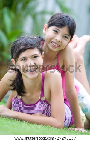 Two teenage sisters enjoying the outdoors