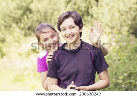 Two teenage sisters in the park - stock photo