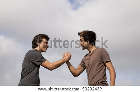 two teenager doing a special handshake