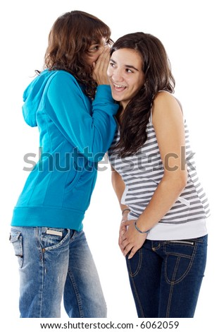 Two teenager girls whispering a secret to the ear - stock photo