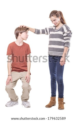 two teenager, sister makes his brother smaller, isolated on white.