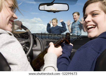 Two teenagers drinking beer and driving a car laughing and not paying attention to the boy and girl that are crossing the street in front of them.  They are about to hit the two kids.