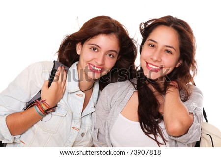 Two teenagers happy with their briefcases in the back - stock photo