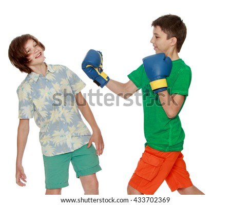 Two teenagers imitating a Boxing match-Isolated on white background - stock photo