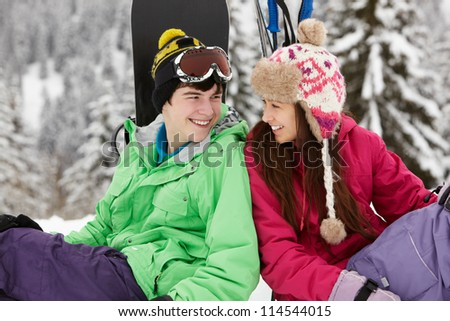 Two Teenagers On Ski Holiday In Mountains - stock photo