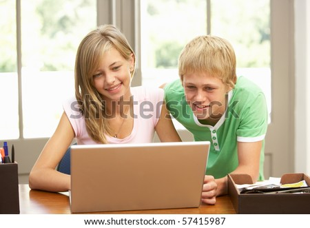 Two Teenagers Using Laptop At Home - stock photo