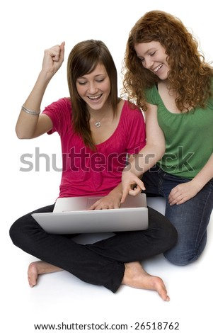 Two teenagers with laptop computer - stock photo