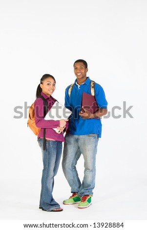 Two teens look ready for school with their backpacks, and notebooks. Vertically framed photograph - stock photo