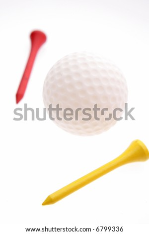 Two tees and golf ball