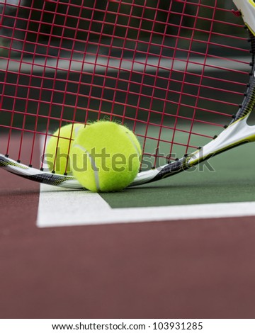 Two Tennis Balls and Racket on Outdoor Court
