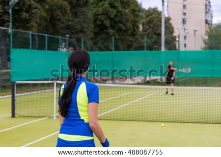 Two tennis players during the game wearing a sportswear outdoor in summer or spring