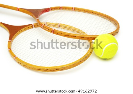 Two tennis rackets and ball isolated on white - stock photo