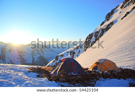 Two tents in mountain - stock photo