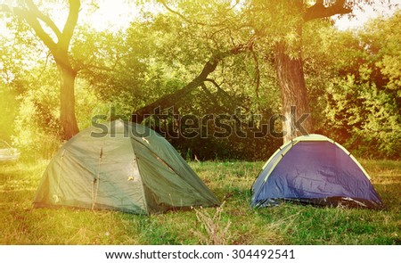 Two tents in the woods in the morning.