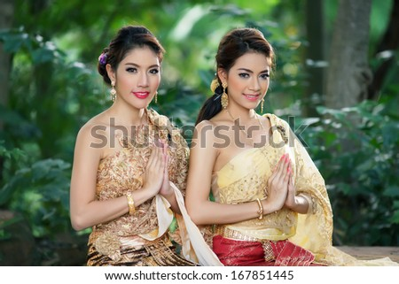 Two Thai woman wearing typical Thai dress, identity culture of Thailand  - stock photo