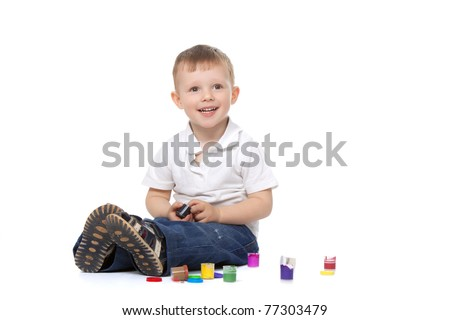 Two, three years old baby boy paints  isolated on a white background - stock photo