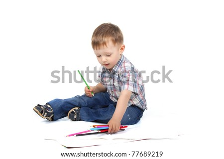 Two, three years old baby boy sitting with color pencil drawing isolated on a white background - stock photo