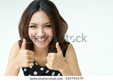 two thumbs up hand sign from beautiful women - stock photo