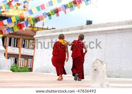 Two Tibetan Children Buddhist Monks walking - stock photo