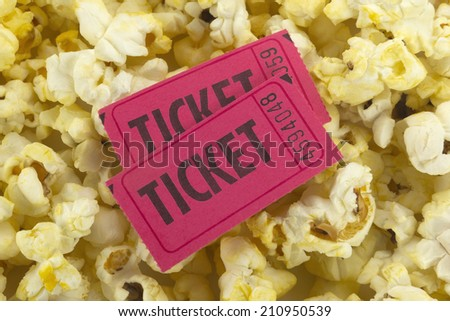 Two tickets on popcorn background.  - stock photo