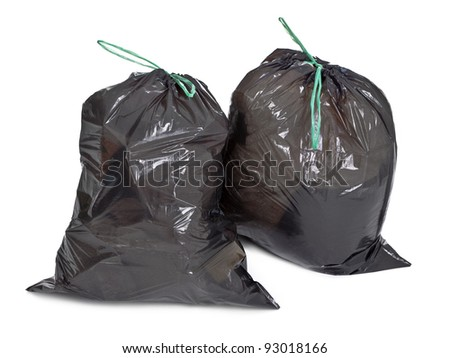 two tied garbage bags on white background - stock photo
