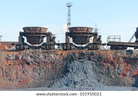 Two tipping bucket on the railway platforms. - stock photo
