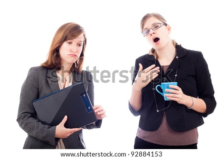 Two tired overworked business women, isolated on white background. - stock photo
