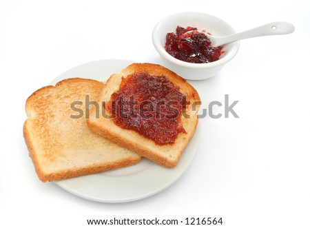 Two toast on a plate with red jam behind. Deliciuos food for breakfast. All white. Look at my gallery for more meals