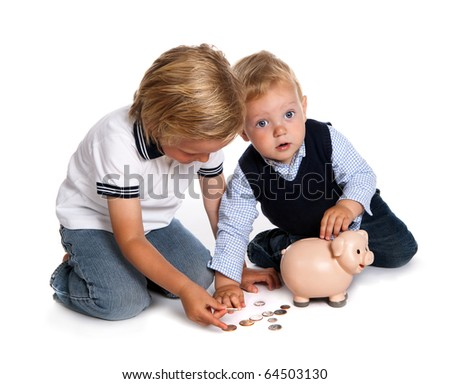 Two toddler brothers playing with money and their pink piggy bank - stock photo