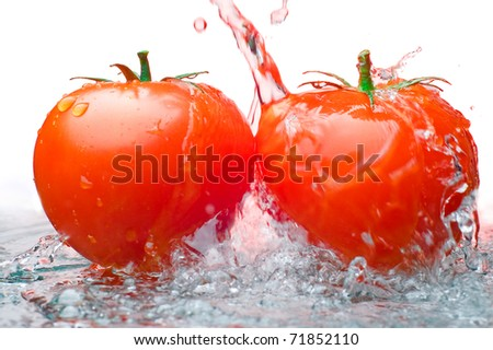 Two tomatos and Water - stock photo