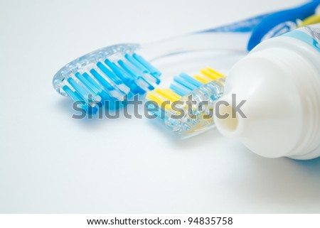 two toothbrushes and a tube of toothpaste - stock photo