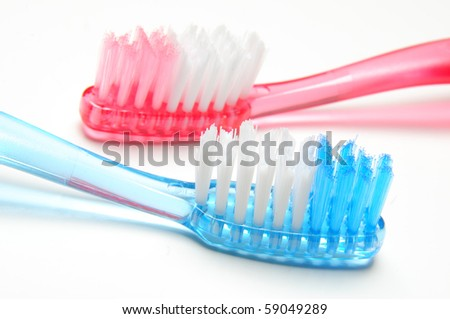 Two toothbrushes on white background - stock photo