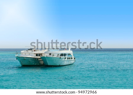 Two tourist boats in the middle of the sea with space for your message. - stock photo